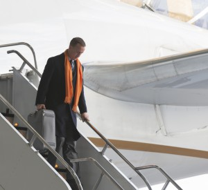 Peyton Manning wears Denver Broncos colors as he exits from a plane. Royalty paid to Shutterstock for use of this image.